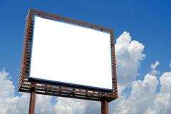 Stock Photo of blank billboard for advertisement on beautiful sky background