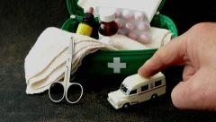 First aid kit with model ambulance. - stock footage