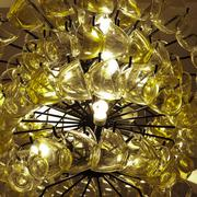 Close up Contemporary chandelier made of many yellow coffee cups. Stock Photos