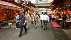 Chinese people walk through Bowrington wet market, Wan Chai Stock Footage