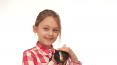 Kid and guinea pig on a white background Stock Footage