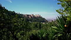 View of the Alhambra palace through greenery.  Granada, Spain. Stock Footage