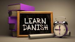 Hand Drawn Learn Danish Concept on Chalkboard Stock Illustration