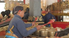 Gamelan player at wayang shadow puppet theatre,Yogyakarta,Java,Indonesia Stock Footage