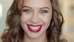 Young beautiful brunette woman shows gorgeous makeup - stock footage