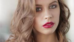 Young beautiful brunette woman demonstrates gorgeous makeup - stock footage