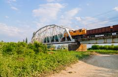 Freight train on the bridge - stock photo