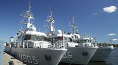 Three naval ships from Denmark in Stockholm in Summer sunshine - stock footage