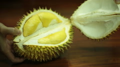 Opening a durian fruit. Stock Footage