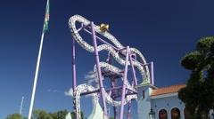 Wide view: Insane coaster at Gröna Lund amusement park in central Stockholm - stock footage