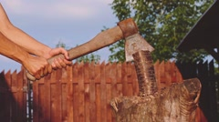 Young strong man is chopping wood outdoors. Slow Motion 240 fps. Stock Footage
