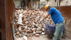 Builder unload construction waste, drop brickbats into trash Stock Footage