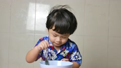 Boy eating rice Stock Footage