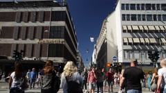 Wide view of people ion Drottninggatan in Stockholm in Summer sunshine - stock footage