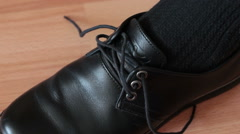 Tying the laces of a shoe. Stock Footage