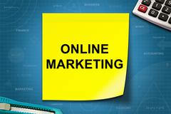 Online marketing word on yellow note Kuvituskuvat