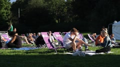 Deckchairs in park in Stockholm in Summer sunshine Stock Footage
