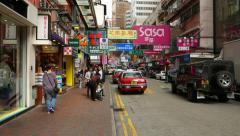 Vibrant shopping street at Hong Kong, many signboards shops around Stock Footage