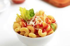 Macaroni with tomato sauce and cheese - stock photo