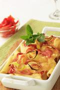 Pasta with ham and cheese in a casserole dish Stock Photos