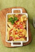 Pasta with ham and cheese in a casserole dish - stock photo