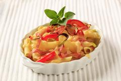 Pasta with ham and pepper topped with cheese Stock Photos