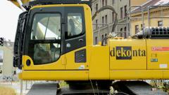 Excavator stands near by city - close view Stock Footage