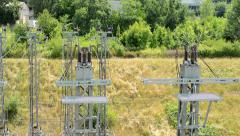 View of the small electric tower in the countryside near by the city Stock Footage