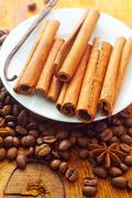 cinnamon and coffee on the white plate - stock photo