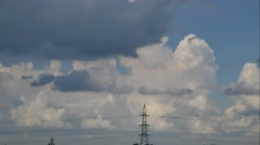 Tall electric masts and cloudy sky - timelapse Stock Footage