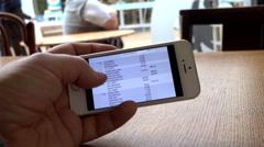 Checking bank balance on smartphone Stock Footage