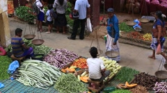 Stock Video Footage of Street sellers in market sell fresh fruits and vegetables. Sri Lanka