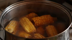 Corn brewed in a pan. - stock footage
