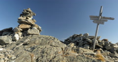 Cairn and sign post on top of mountain Stock Footage