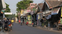 Small shops with traffic,Yogyakarta,Java,Indonesia Stock Footage