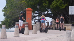 Tourist on segways on waterfront promenade - Old San Juan Stock Footage