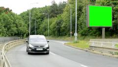 Billboard stand by the rush road in the countryside - green screen Stock Footage