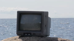 Cool video in nature. From TV comes out of long ship Stock Footage