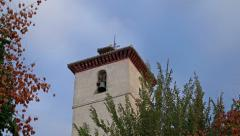 Slow zoom in on old brick church tower in Granada, Spain. - stock footage