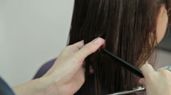 Hairdresser trimming brown hair with scissors Stock Footage
