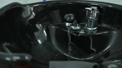 Black sink for hairdressers Stock Footage