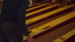 A man playing skee ball Stock Footage