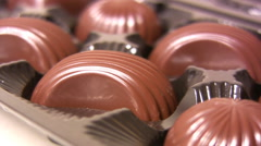 Hand picking candy from box of chocolates Stock Footage