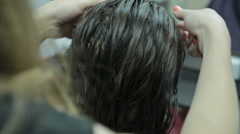 Close-up hairdresser combing and blow dry for client hair in hairdressing salon Stock Footage