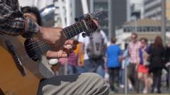 Street busker on guitar, Wynyard Quarter, Auckland Stock Footage