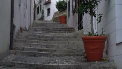 Stock Video Footage of Panning upward shot of ancient cobblestone stairs in Granada, Spain.