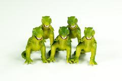 Toy Dinosaurs: Five Llittle Models of a T-Rex - stock photo