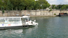 A boat passing thorugh the Siene river in Paris Stock Footage