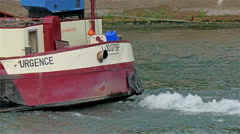 The Urgence boat cruising in Siene river Stock Footage