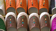 "Stock Video Footage of Colorful Arabic slippers for sale in the ""Medina"" district of Granada, Spain."